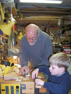 In my old shop with my grandson, Russell.