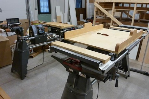 Two Marks in business. The Closet Pro, LLC uses two Shopsmiths; the front machine is set up as table saw and jointer (notice client-made cross cut sled); rear machine, Mark 7, is set up for horizontal boring, belt sander and drum sander.